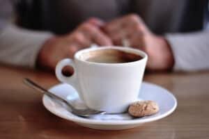 Cafe Med Kaffeetasse